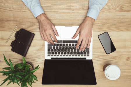 businessman working with laptop, smartphone and diary at workspace