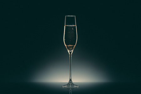 one transparent glass with champagne Фото со стока