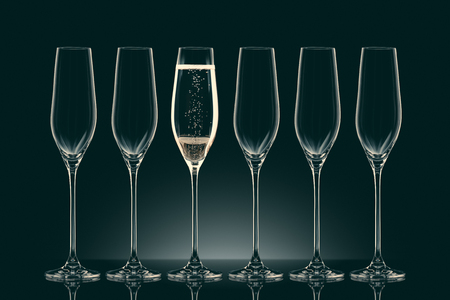 five empty glasses and one glass with champagne Фото со стока