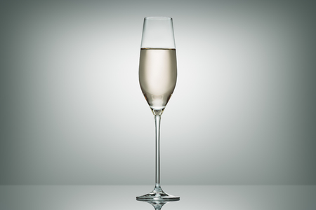 one glass with calm champagne