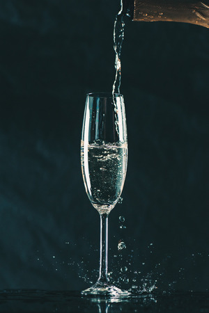 pouring champagne from bottle into glass Stock fotó
