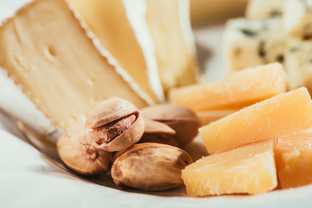 cheese plate with nuts and sauce