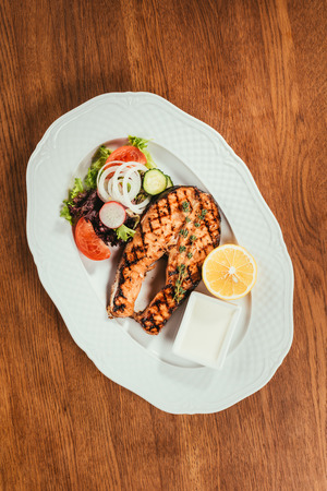 grilled salmon fish pieces with lemon