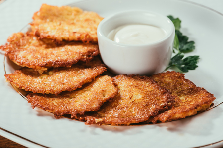 potato pancakes served with sour-cream sauce