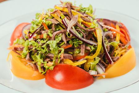 fresh vegetables sliced on white plate Stock Photo