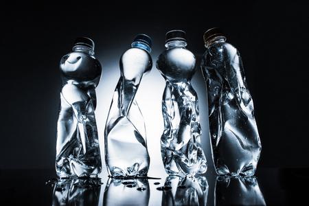 row of crumpled bottles of water Stock fotó