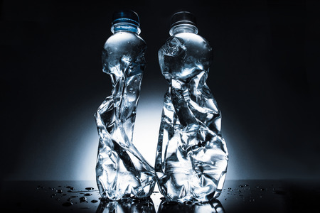 still life with crumpled bottles of water