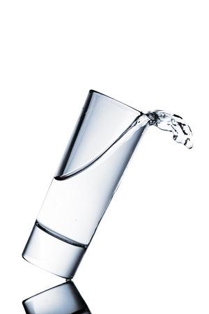 ガラスからこぼれる水 写真素材
