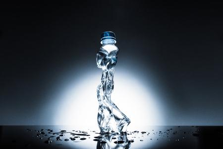 crumpled plastic bottle of water