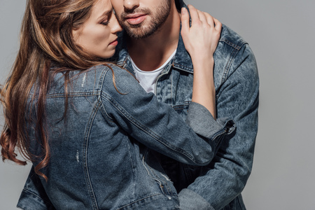 cropped shot of seductive young couple hugging
