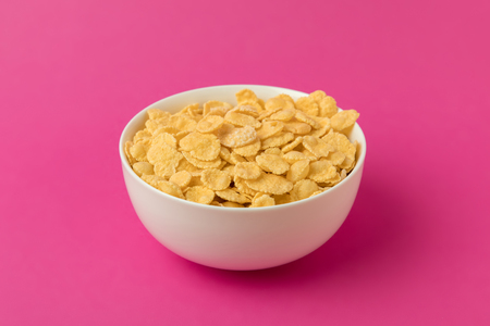 close-up view of white bowl with sweet tasty corn flakes Фото со стока