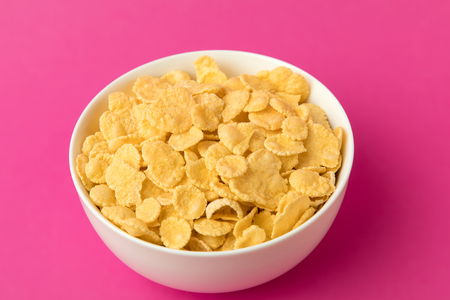 close-up view of white bowl with sweet healthy corn flakes Imagens