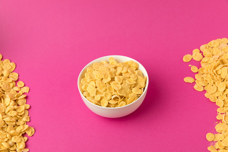 high angle view of white bowl with sweet healthy corn flakes