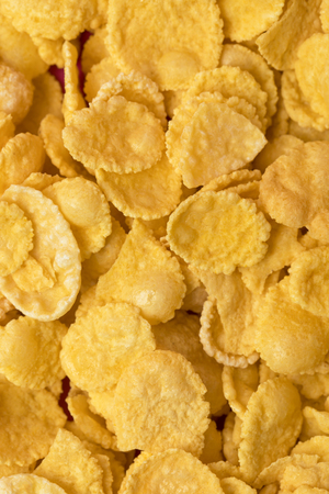 frame background from healthy crispy corn flakes Фото со стока