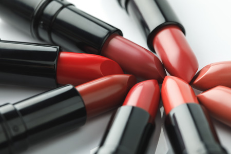 close-up shot of red lipsticks of various shades