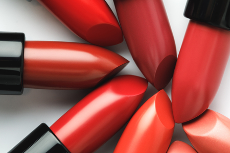 close-up shot of red lipsticks of different shades