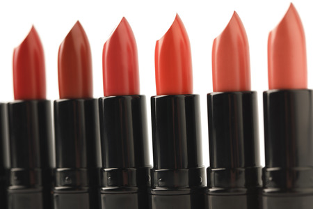 close-up shot of row of red lipsticks of various shades