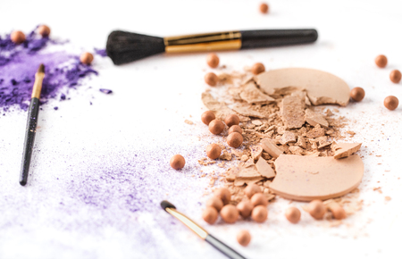 various cosmetic powder with brushes