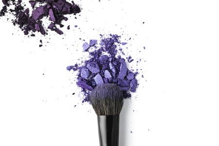 crushed purple cosmetic powder with brush