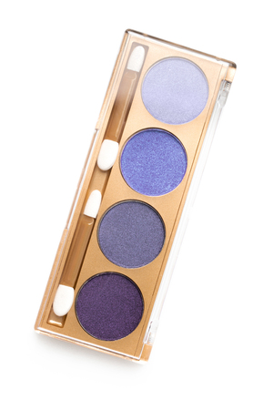 top view of case with different shaded purple cosmetic eye shadows Foto de archivo