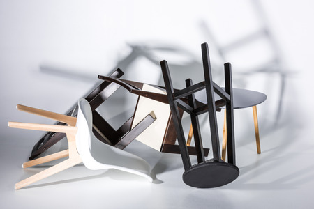 Pile of different modern stylish chairs