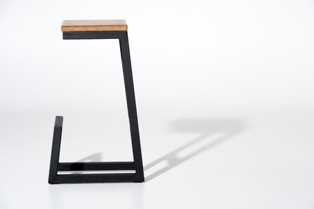 Studio shot of tall wooden barstool Banque d'images - 93508241