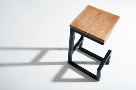 Studio shot of tall wooden barstool