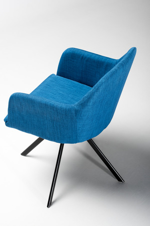 Studio shot of stylish chair with blue fabric top