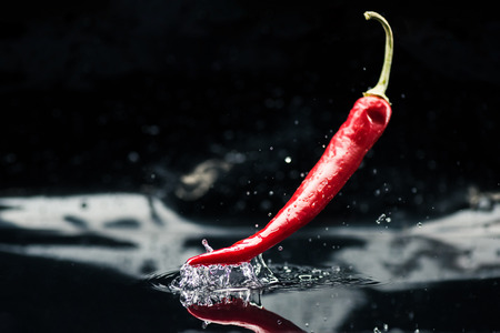chili pepper falling in water