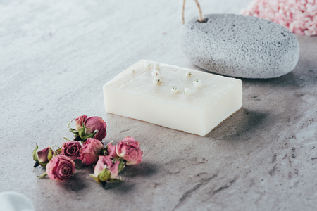 spa treatment, dried roses, natural soap and pumice