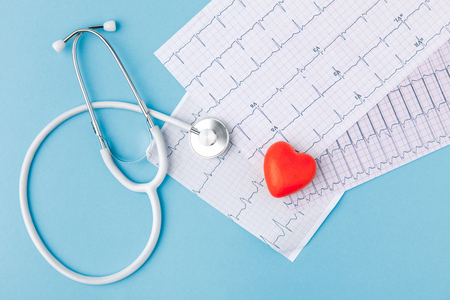 stethoscope, cardiogram and red heart