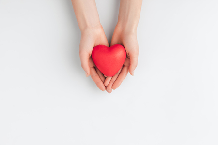 hands holding red heart isolated on white background Stock Photo