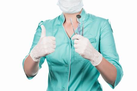전문 치과 의사와 치과 도구