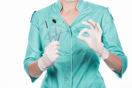 professional dentist holding tools