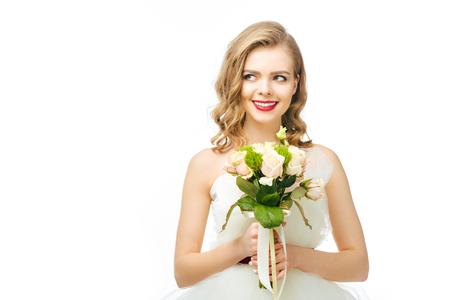 portrait of beautiful pensive bride with wedding bouquet