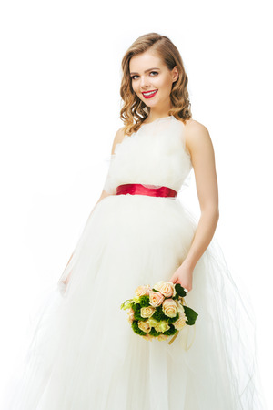 portrait of beautiful cheerful bride with wedding bouquet Stock Photo - 93600339
