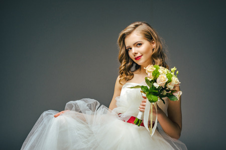 beautiful bride with wedding bouquet in hand Stock Photo