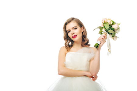 portrait of beautiful bride with wedding bouquet in hand Stock Photo