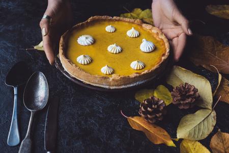 female hands placing pie on counter 版權商用圖片