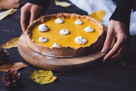 female hands placing pie on table 版權商用圖片