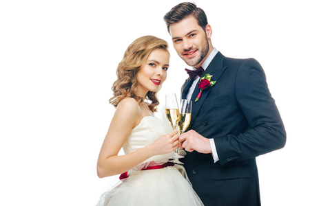 portrait of beautiful wedding couple with glasses of champagne Stock Photo