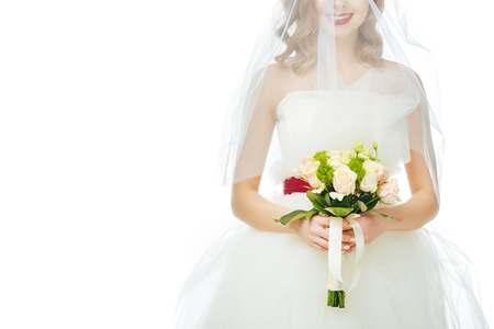bride in wedding dress and veil with wedding bouquet in hands