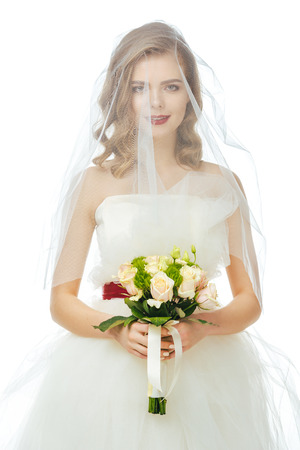 pretty bride in wedding dress and veil with wedding bouquet in hands isolated on white