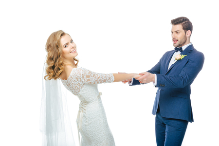 beautiful wedding couple holding hands while dancing together