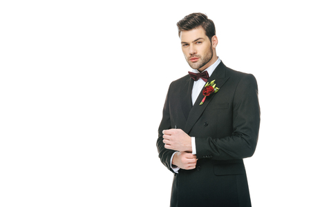 young groom in suit with boutonniere isolated on white Stock Photo
