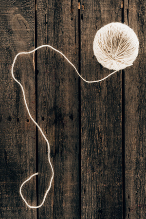 knitting yarn ball on wooden background