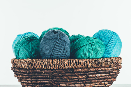 warm yarn balls in wicker basket