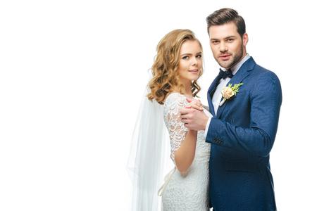 bruid en bruidegom dansen samen geïsoleerd op wit Stockfoto