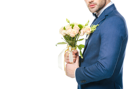 groom with bouquet of flowers isolated on white