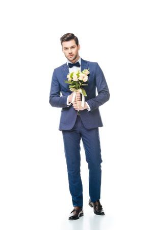 groom with wedding bouquet in hands isolated on white
